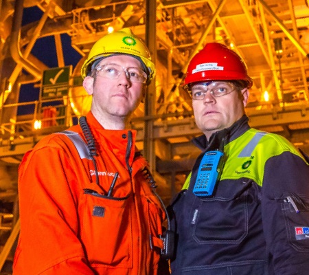 workmen in arc flash protective clothing