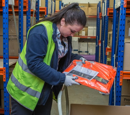 woman checking delivery information on ProGARM product