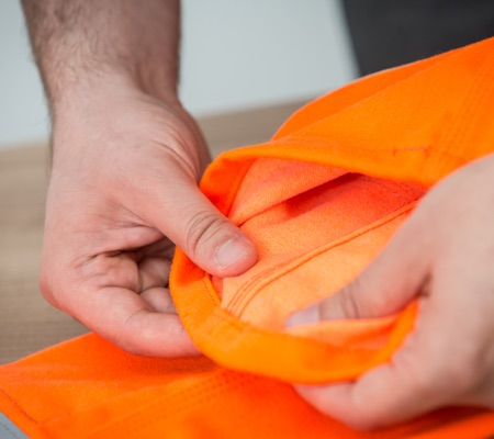 close up of orange hi vis arc flash protective fabric