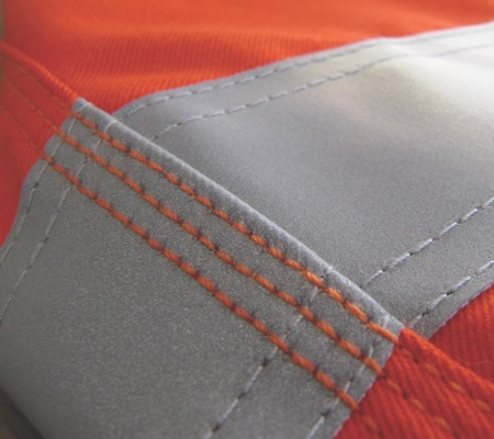close up of hi vis orange fabric